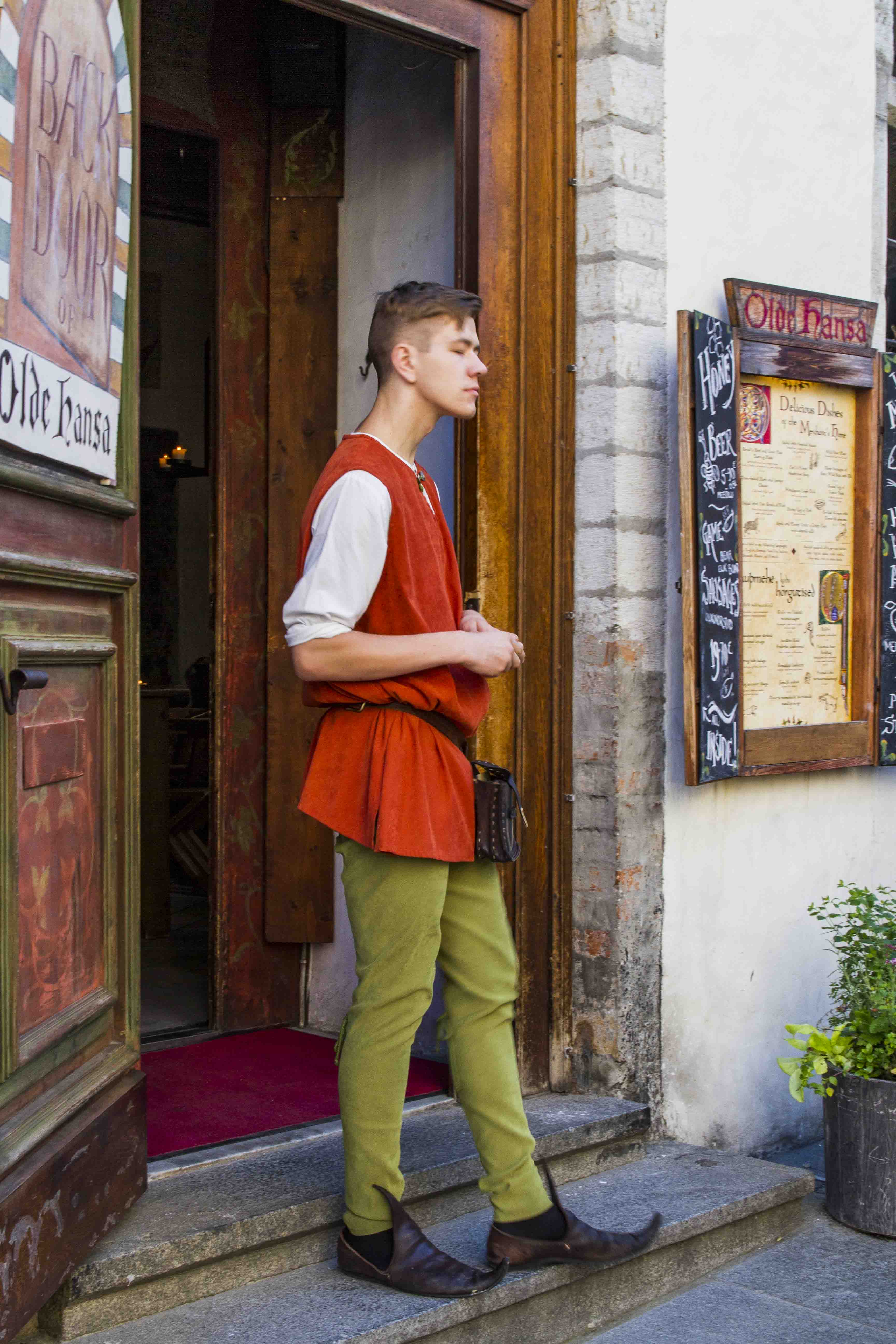 tallinn old town - a young man in medieval clothes
