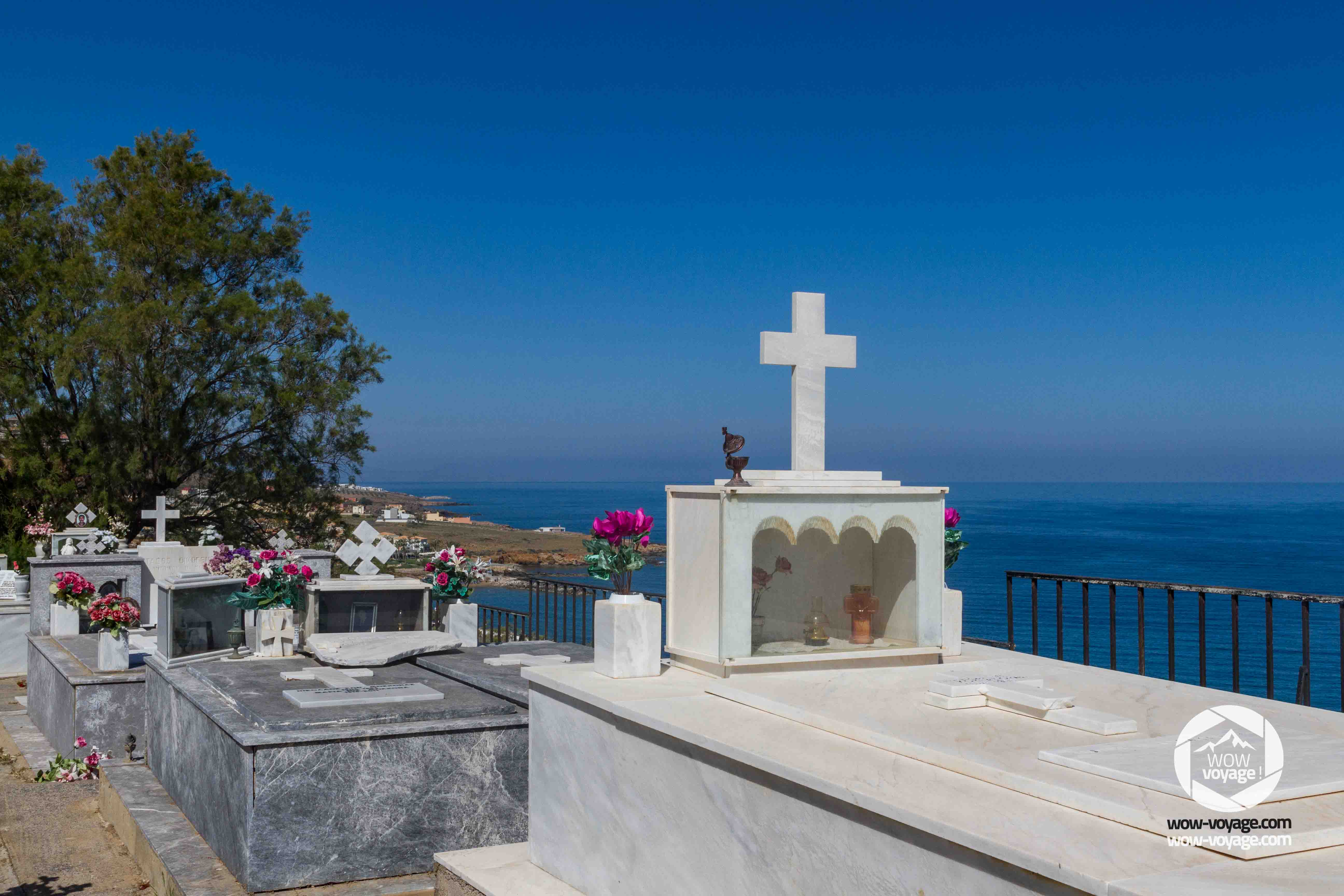 falls in the Panormo cemetery, overlooking the sea and the village of Panormo,