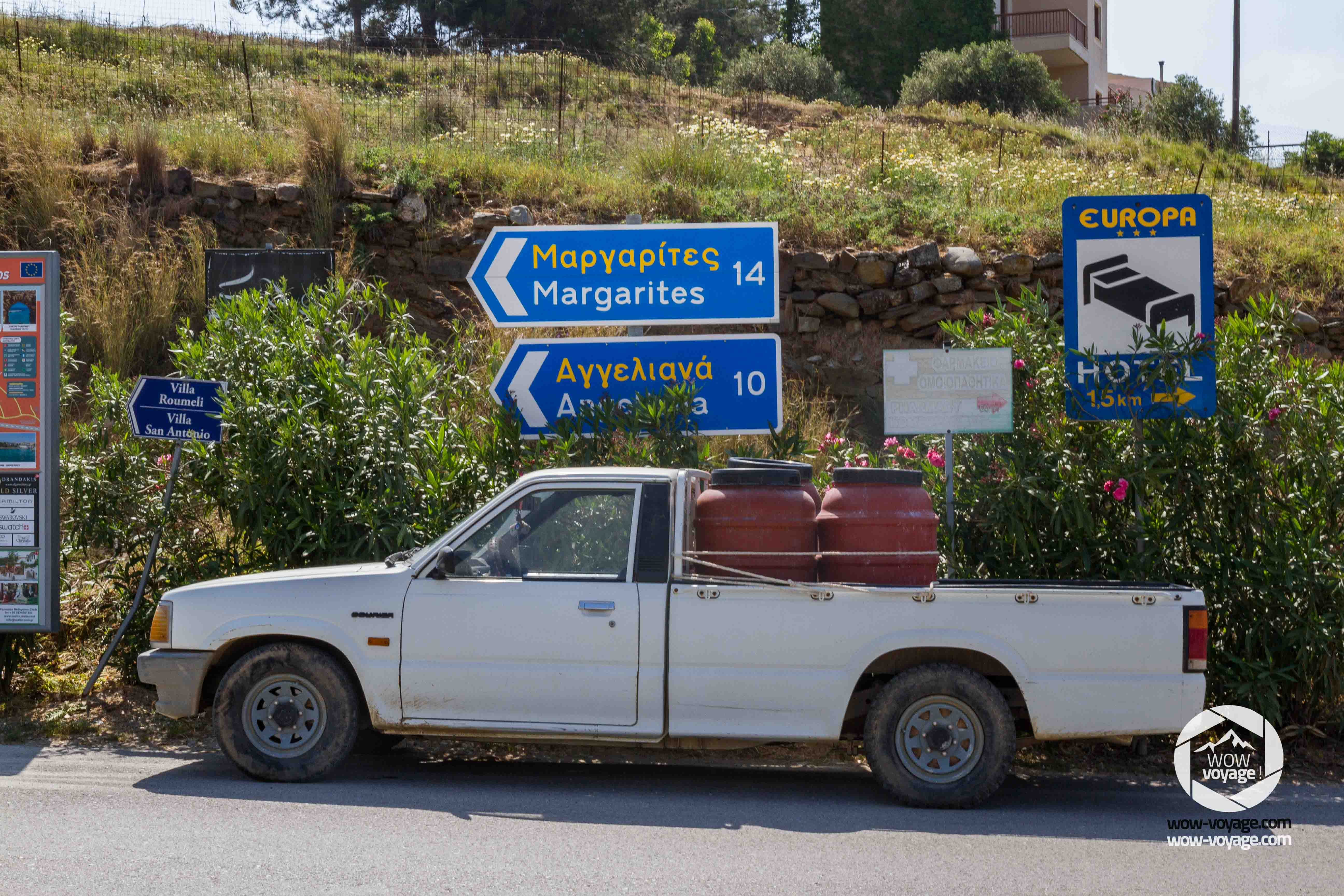 road sign on a road in a village in greece, crete